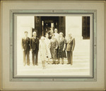 Dr. Leo Stanton Rowe (?), Director General of the Pan American Union, photographed with an unidentified group of people on the front steps of the Pan-American Union