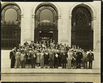 Photograph of Dr. Leo Stanton Rowe, Director General of the Pan American Union, standing on the front steps of the Pan-American Union with an unidentified group of people