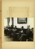 Photograph of men sitting in chairs