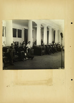 Photograph of men in microphone room