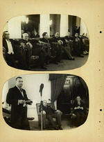 Photograph of men listening to a speaker