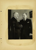 Photograph of two men shaking hands