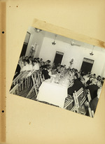 Photograph of people at banquet