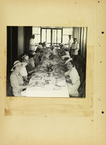 Photograph of women sitting in table