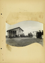 Photograph of people in a line near house (copy 2)