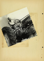 Photograph of man on tractor