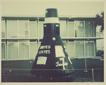 Photograph of (model) space capsule Friendship 7 in front of Holiday Inn