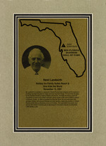 """A framed award from the Junior Achievement """"Mid-Florida Business Hall of Fame"""" to Henri Landwirth"""