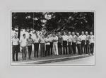 A photograph of 16 men