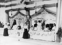 Ladies of the Sacred Heart Church give a fair or bazaar for benefit of the building fund.