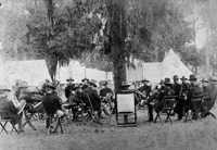 Officers strategize in their Tampa encampment before embarkment to Cuba..