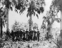 A Platoon of soldiers posing during field maneuvers.