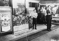 Boys await a movie outside the El National Theatre in Ybor City.