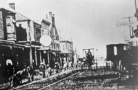 A Very early view of 7th Avenue as the tracks are being placed for the trolley cars.
