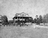 The Large, three story, circular porched V. Martinez Ybor home at the north west corner of 12th Avenue and 17th Street.