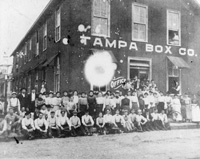 Employees in front of Tampa Box Company Building on 21st Street between 1st and 2nd Avenues.