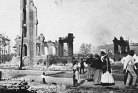 People evaluate the aftermath of the Ybor City Fire of 1908.
