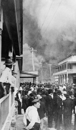 A Crowd watches the La Trocha Cigar Factory engulfed in flames during the Ybor City Fire of 1908 from 12th Avenue and 17th Street North.