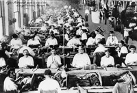Cigar makers at work in the early Ybor Cigar Factory.