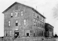 A Very early photograph of the El Grifo Cigar Factory.