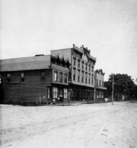 A View of Branch's Opera House and Emery, Simms, and Emery, Boots and Shoes around 1870.