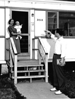 Charles LaPradd waves goodbye to his wife, Nita, and baby, Tommy.