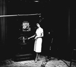 A woman stands in WUFT studio at the University of Florida