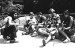 Four students playing guitars on University of Florida campus