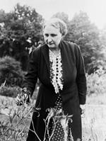EdithTigert stands in a garden