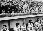 Partial view of fooball team and spectators.
