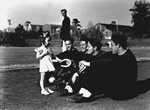 Little girl hands horseshoe to four University of Florida track team members.