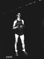 Frank Yinshannis holds basketball on court at the University of Florida