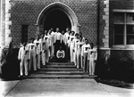 18 men pose on the steps of a building on the University of Florida campus