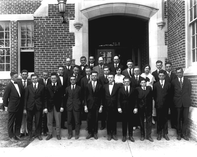 Group of people standing in front of entrance to Bryan ... - photo#49