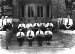 Group of men seated on steps of Floyd Hall at the University of Florida