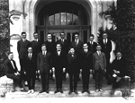 Group of men standing at entrance to Language Hall on the campus of the University of Florida.