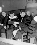 United States Vice President Alben Barkley showing his honorary degree he received from the University of Florida.