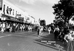 Band marching in a 1949 Christmas parade