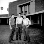 University of Florida freshmen class officers John Donnohoo, Dick Adams, and Jon Johnson stand outside of the Hub bookstore