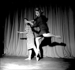 Two University of Florida women students dance for a class