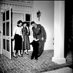 University of Florida President J. Wayne Reitz, his wife Frances, and daughter pose on the front porch of the University President's House in Gainesville, Florida
