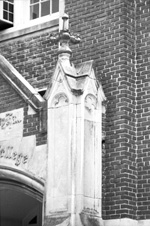 Detail of exterior architectural feature on the front of Peabody Hall.