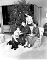 University of Florida President J. Wayne Reitz and his family with pet cocker spaniel at home during the Christmas season