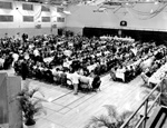 Overview of tables and people at Florida Blue Key banquet during Homecoming at the University of Florida