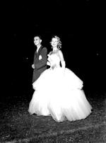 University of Florida president, Dr. J. Wayne Reitz escorts Mary Lou Denyse, Miss University of Florida.