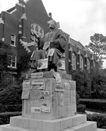 Albert Murphree statue covered with posters. University Library to left.