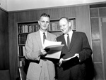University of Florida president Dr. J. Wayne Reitz and University Vice President Harry M. Philpott Philpott look over some papers.