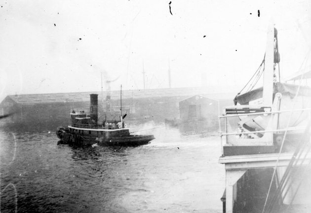 Photo: View of S.S. Cathlamet's tugboat from aboard ship.