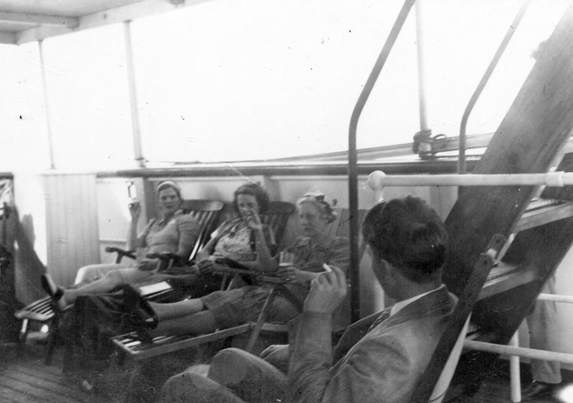Photo: Four passengers on board S.S. Cathlamet.