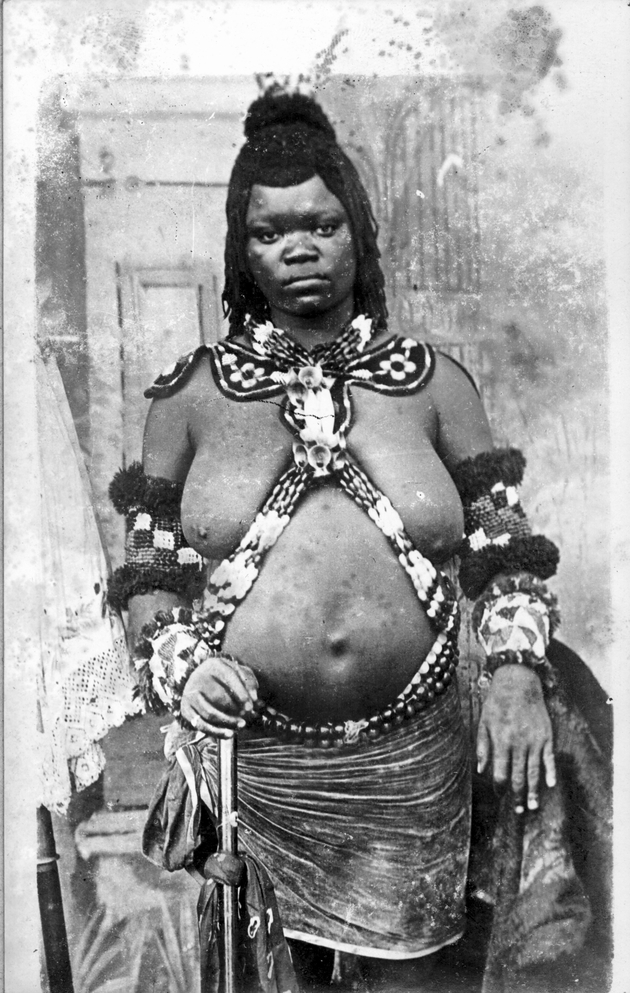 Postcard portrait of African woman in traditional dress.